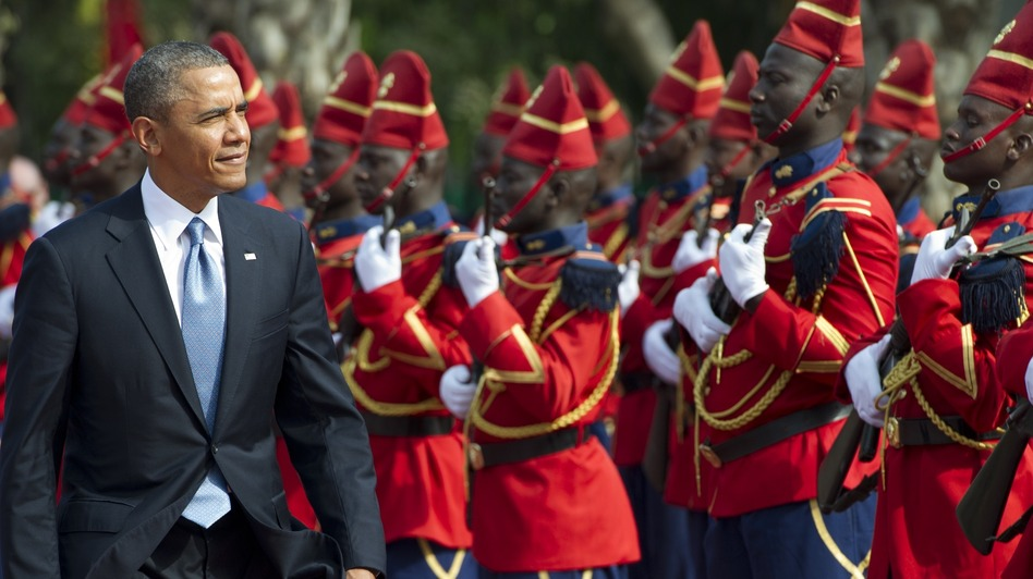 President Obama reviews an honor guard on Wednesday outside the presidential palace in Dakar, Senegal. (AFP/Getty Images)