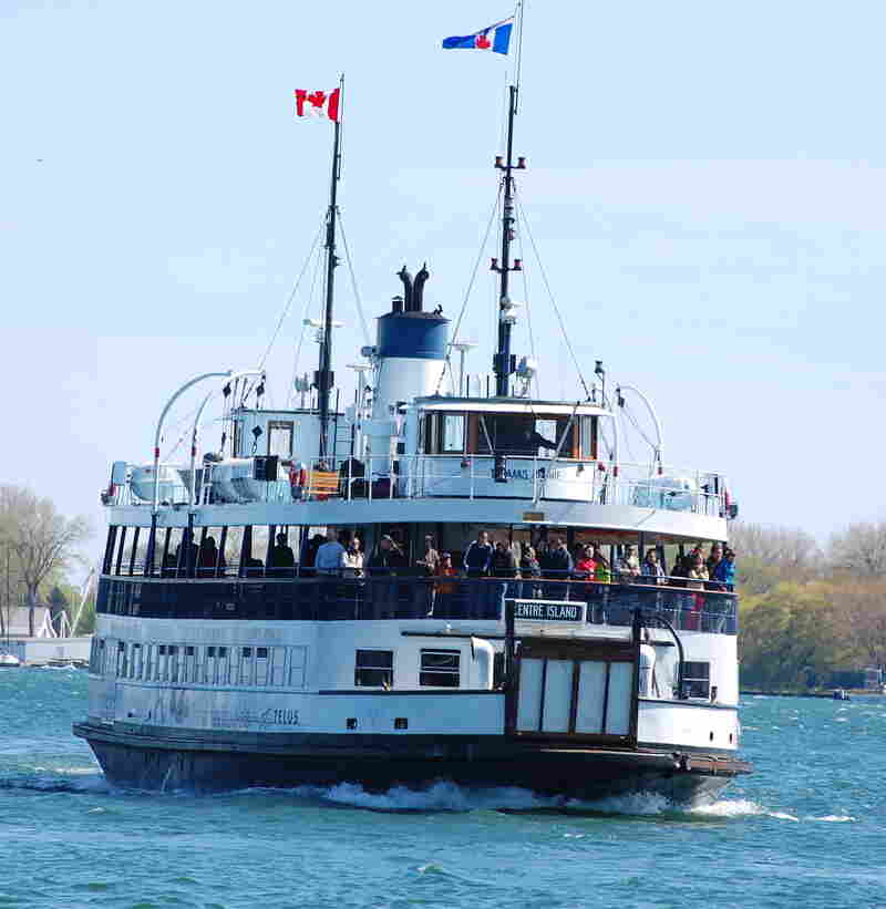A 20-minute ferry ride takes passengers from the bustling waterfront to the wooded parks of the Toronto Islands.