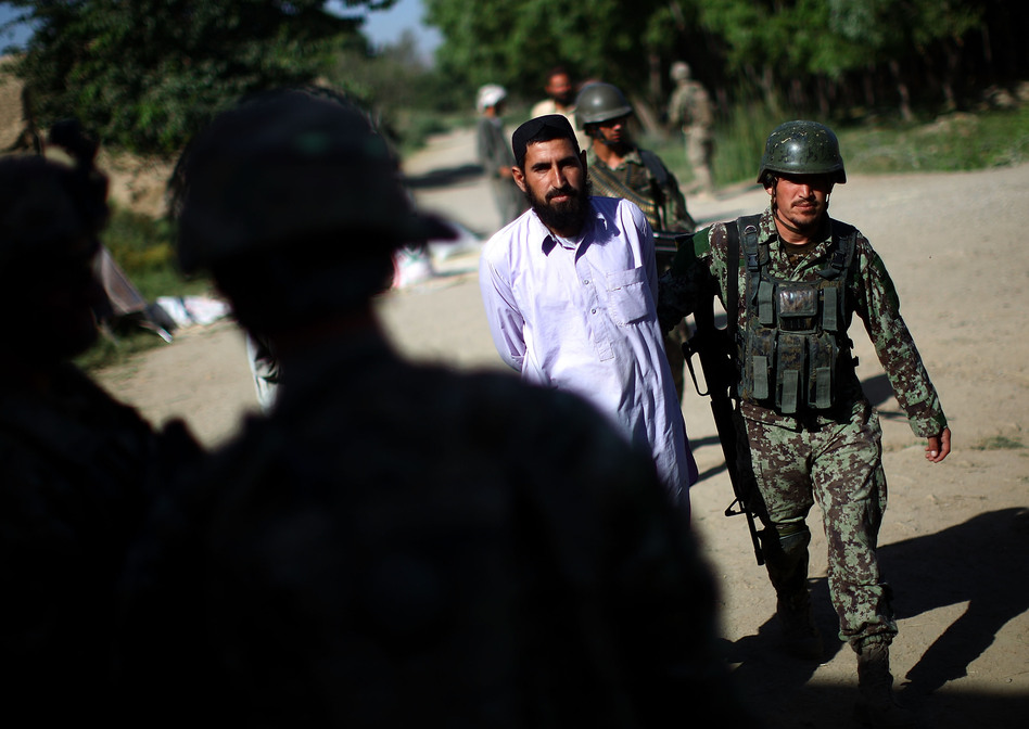 An Afghan Army soldier brings in a local farmer the Americans wanted detained. The American soldiers later handed the man back to the Afghans, who eventually let him go. The incident stoked both anger and fear among local residents. (NPR)