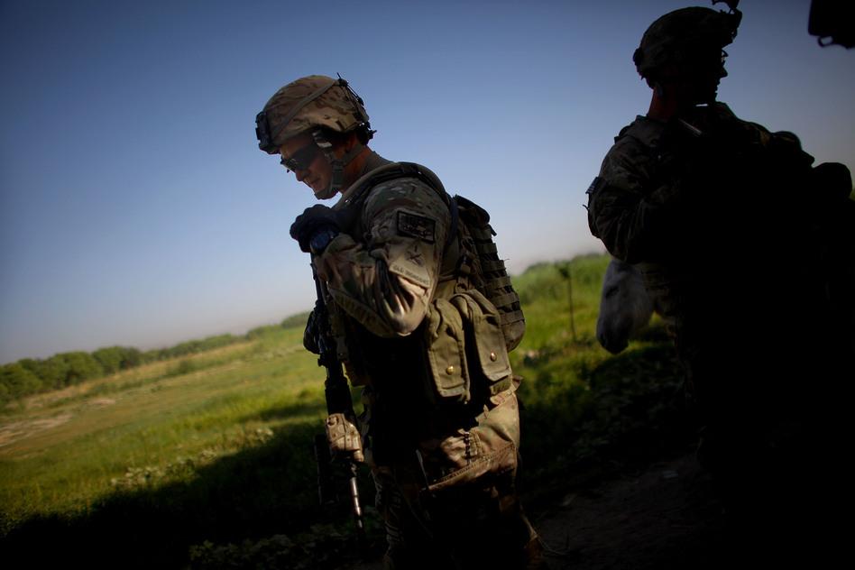U.S. Army Sgt. Sean Rodman helps lead a foot patrol in Arghandab. (NPR)