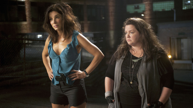 Sandra Bullock (left) plays an FBI special agent whose usual composure gets ruffled when she's paired with a Boston cop (Melissa McCarthy) with little patience for procedure. (Fox )