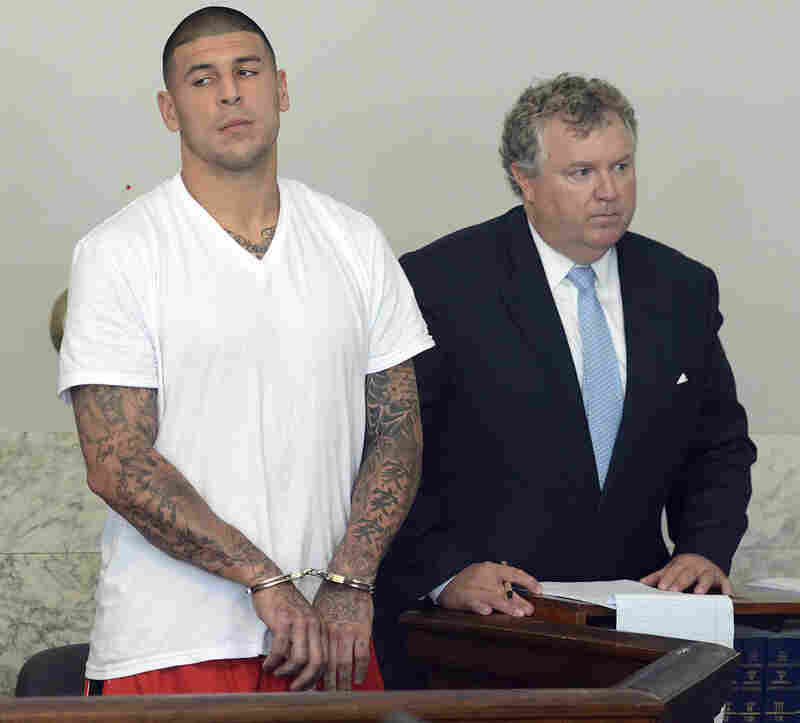 Former New England Patriots tight end Aaron Hernandez will be held without bail on murder charges, a judge has confirmed. Here, Hernandez, left, stands with one his defense attorneys, Michael Fee, during his arraignment in Attleboro District Court Wednesday.