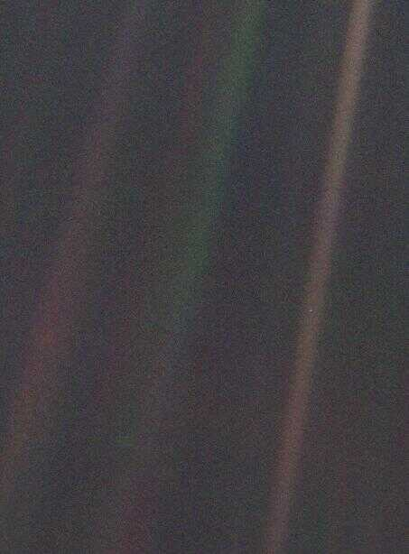 "Voyager 1 image of Earth as ""Pale Blue Dot."" NASA Image PIA00452"