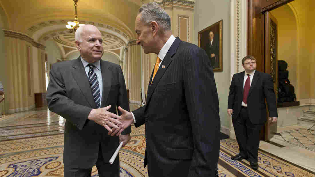 "The Senate has passed a sweeping immigration bill, widely seen as the product of the ""Gang of 8,"" a group that includes Sens. John McCain, R-Ariz. (left), and Sen. Chuck Schumer, D-N.Y. The two shook hands before Thursday's final vote."