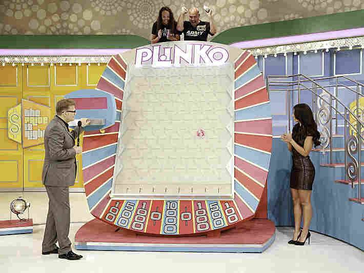 Carlos Santiago and his daughter, Jasmine, play Plinko as show host Drew Carey and model Manuela Arbelaez on a special Father's Day episode of The Price Is Right. (Plinko is terrible.)