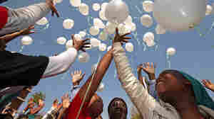 Children release 95 balloons to mark Nelson Mandela's upcoming birthday outside the Mediclinic Heart Hospital where Mandela is being treated for a recurring lung infection in Pretoria, South Africa.
