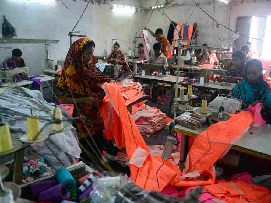 Bangladeshi workers in a small garments factory.
