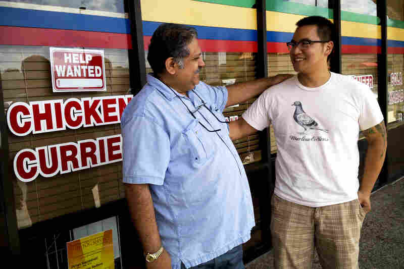 Justin Yu, one of Houston's celebrated young chefs (right), outside Houston's Himalaya Restaurant with owner Kaiser Lashkari.