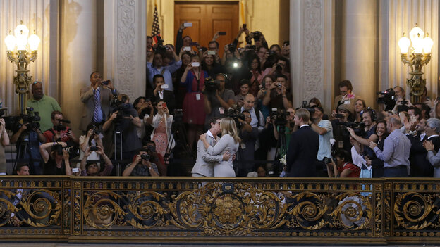 Kris Perry, left, kisses Sandy Stier as they are married at City Hall in San Francisc