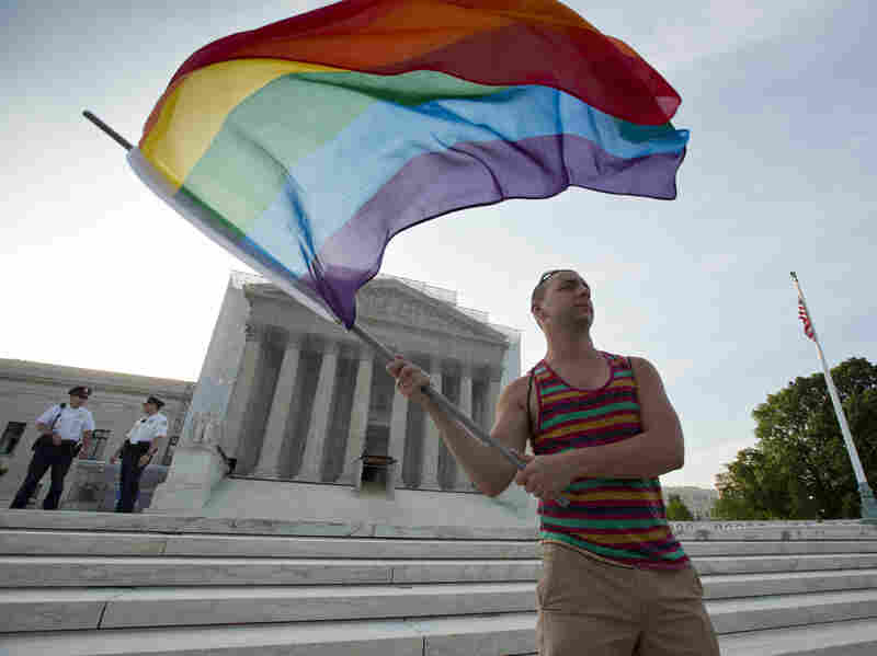 Gay rights advocate Vin Testa waves a rainbow flag in front of the Supreme Court on June 26, 2013.