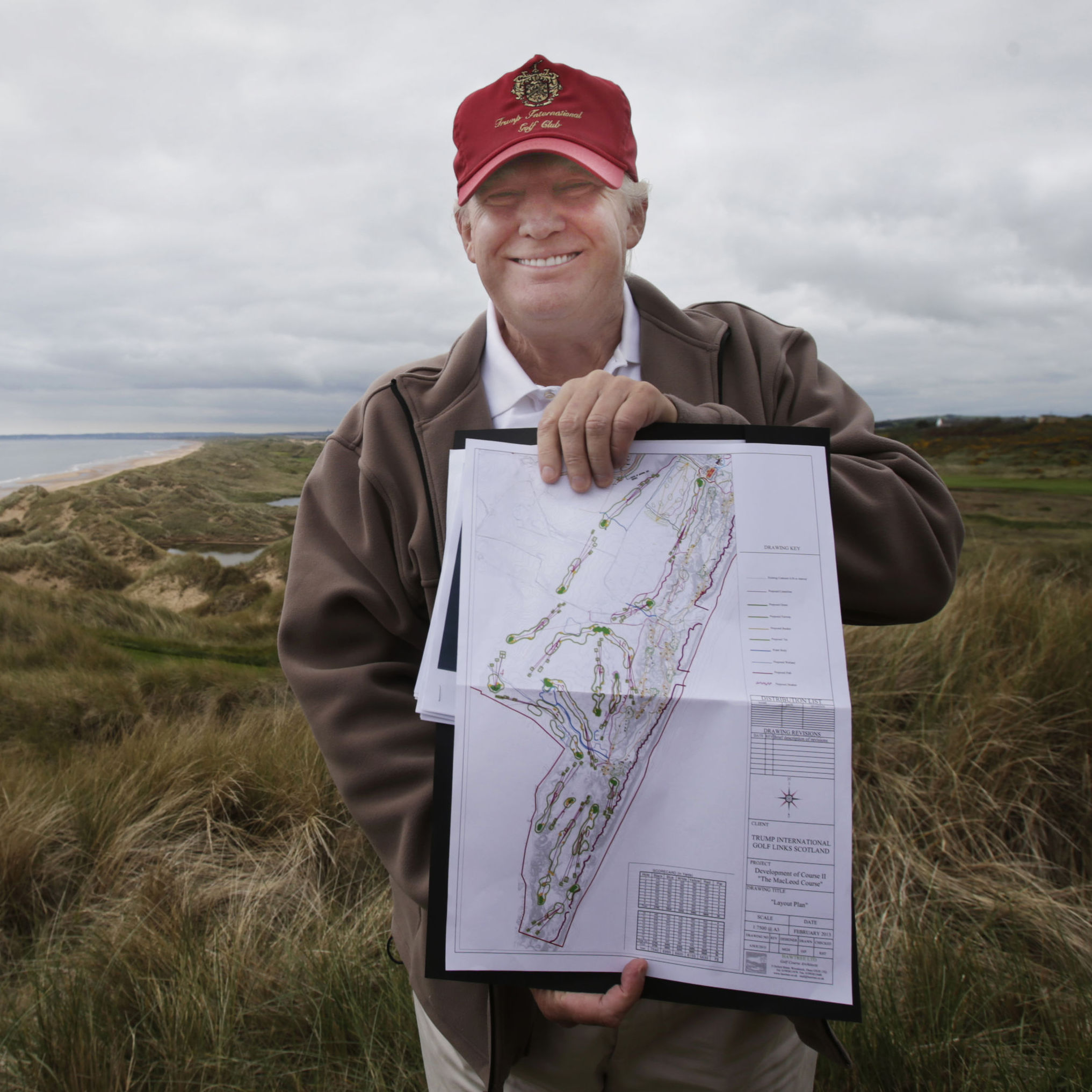 Trump holds the plans for the MacLeod Course, his second Scottish golf course, during a visit to the Trump International Golf Links, on June 6.