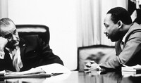 President Lyndon Johnson discusses the Voting Rights Act of 1965 with civil rights leader the Rev. Martin Luther King Jr.
