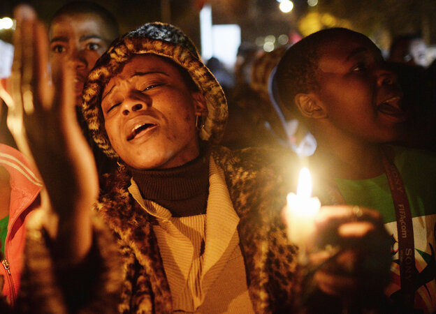 Friday in Pretoria, South Africa, people gathered outside a hospital to pray for former President Nelson Mandela. He remains in critical condition with a lung infection.