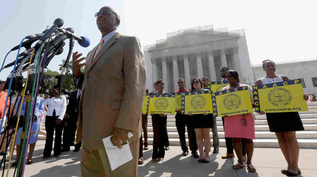 Field director Charles White of the NAACP speaks at a