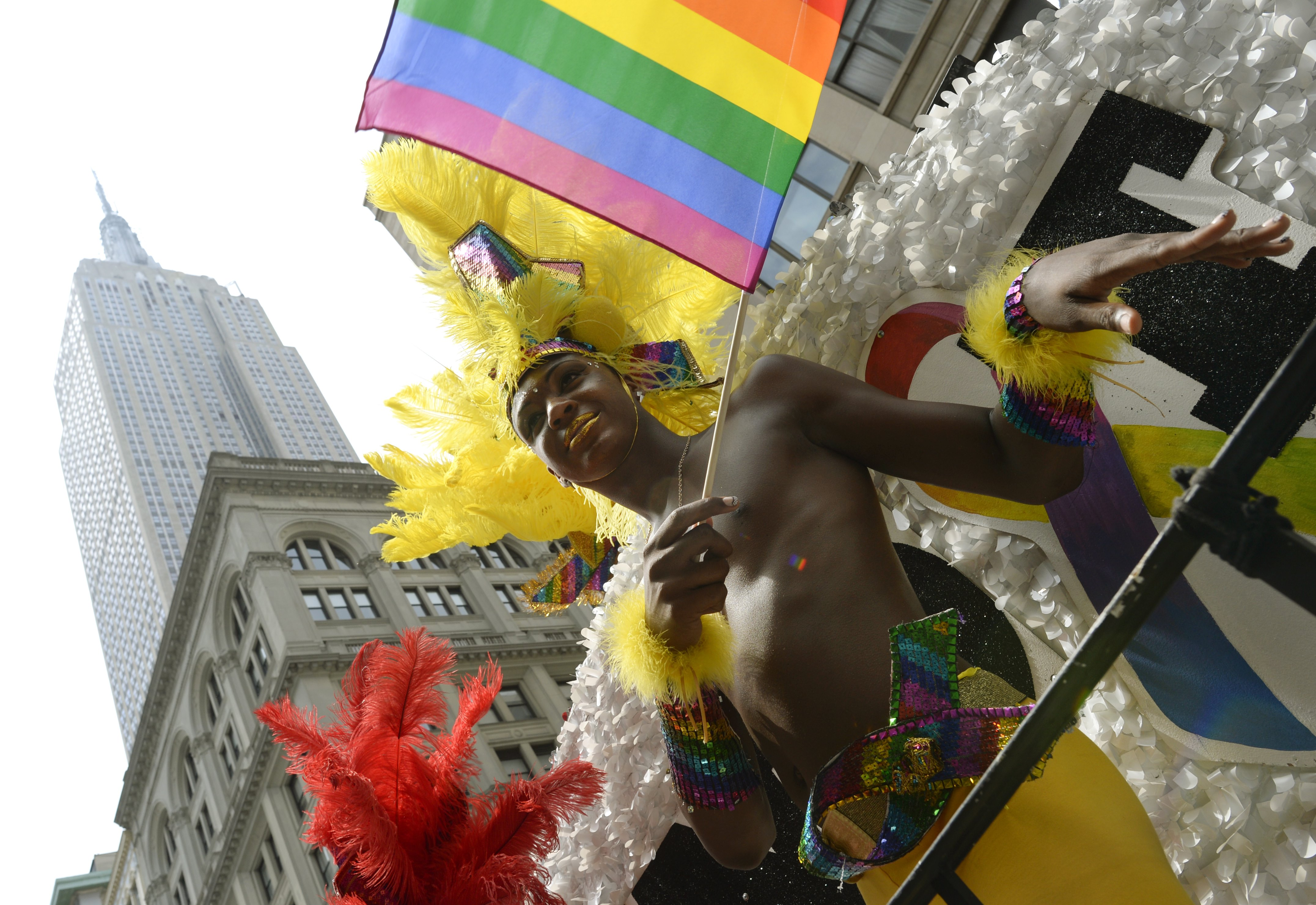 The Supreme Court on Wednesday struck down Proposition 8 and also invalidated part of a 1996 federal law that denied spousal benefits to gay couples, making New York's Pride Parade especially festive.