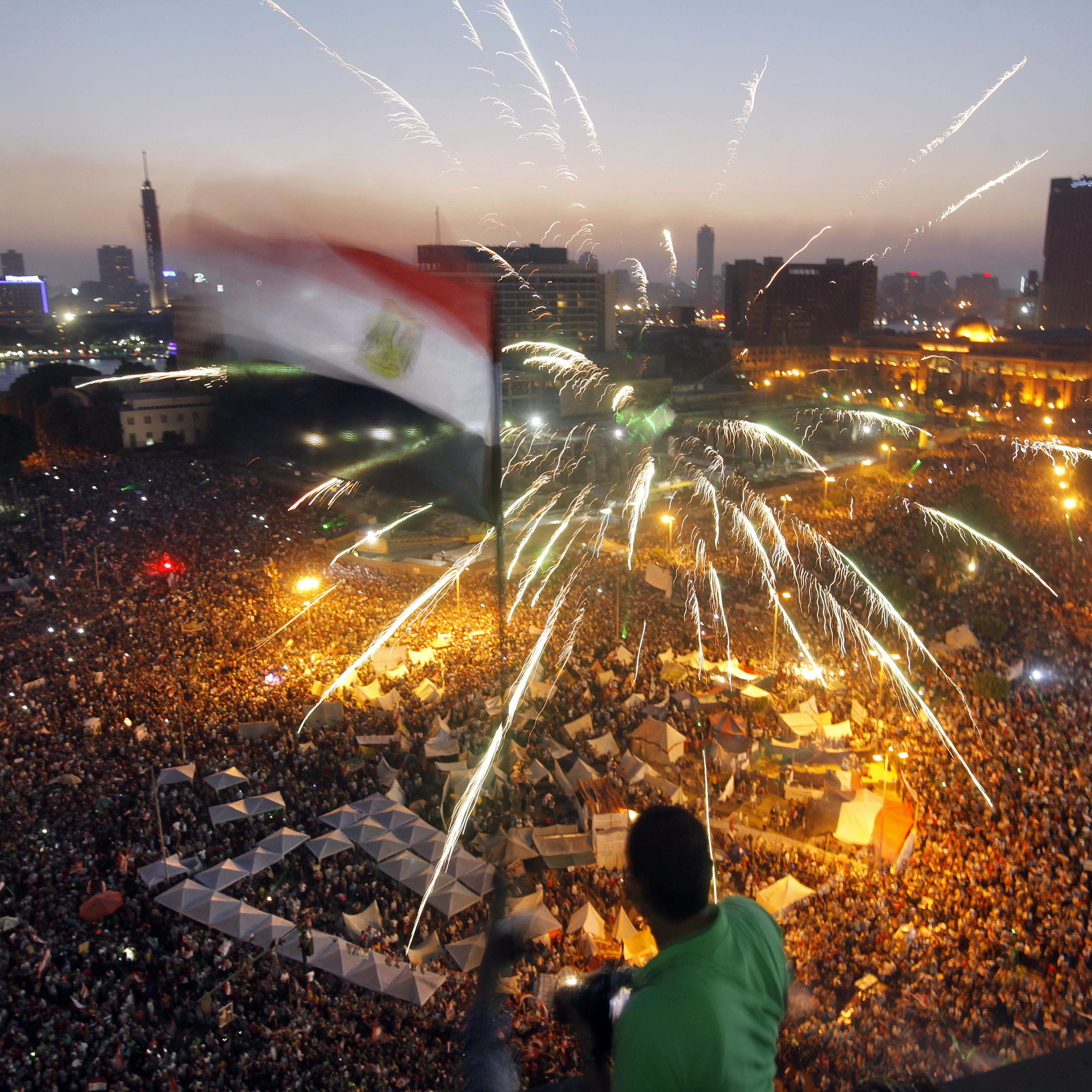 Egyptians gather in Tahrir Square during a demonstration against President Mohammed Morsi in Cairo on Sunday. Hundreds of thousands of Morsi opponents poured out onto the streets across much of Egypt, launching an all-out push to force him from office on the first anniversary of his inauguration.