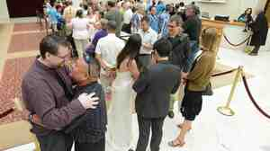 Lining up to be married: Adam Chandler, 33, left, and Ivan Chandler, 38, both of Citrus Heights, were among those waiting in line Saturday to get married at San Francisco City Hall.