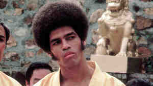 This 1973 photo released by Warner Bros. Entertainment shows Jim Kelly as Williams in a scene from Enter the Dragon. Kelly, who played a glib American martial artist in the movie, died Saturday of cancer at his home in San Diego. He was 67.