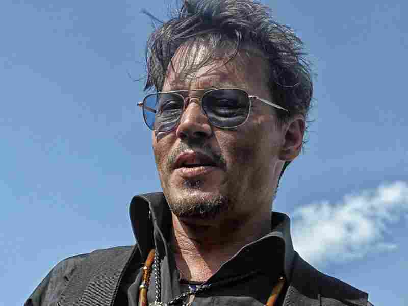 Johnny Depp pauses on the red carpet before the Comanche Nation premiere of The Lone Ranger.