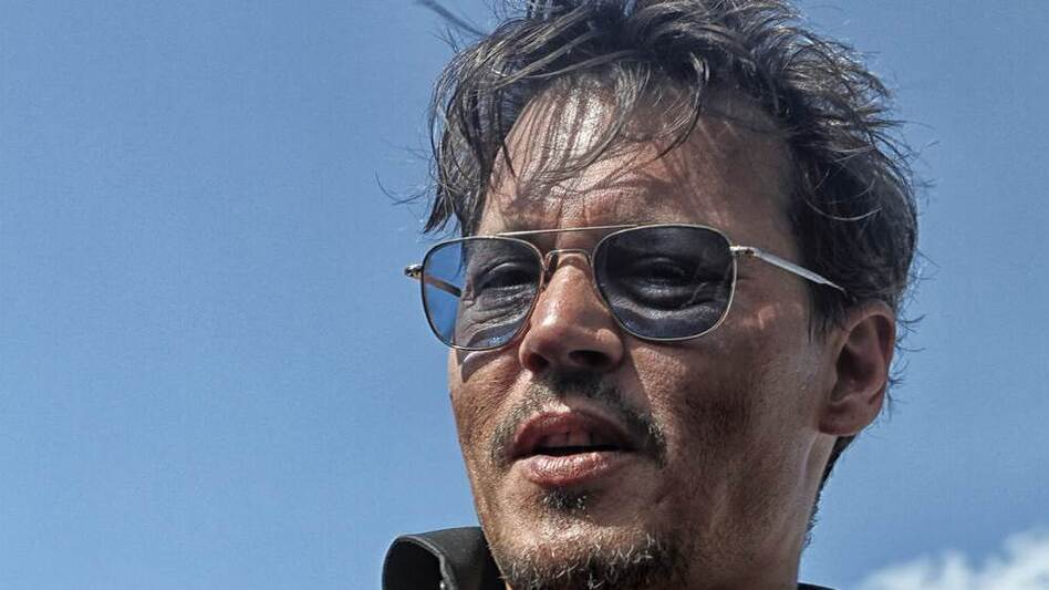 Johnny Depp pauses on the red carpet before the Comanche Nation premiere of The Lone Ranger. (M.J. Alexander)