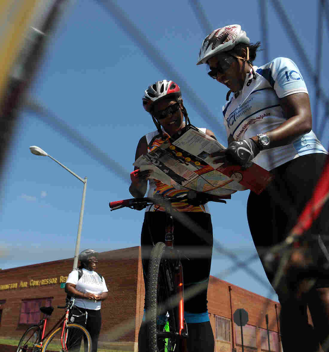 Members of Black Women Bike: DC consult a map while on the road at an event in June 2011.