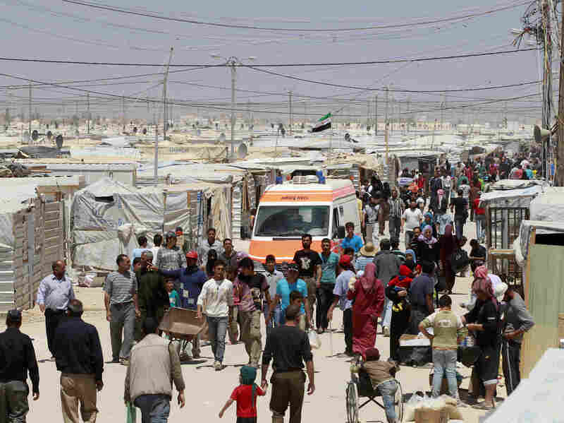 Syrian refugees at Zaatari refugee camp in the Jordanian city of Mafraq, near the border with Syria, on April 25. The massive influx of refugees fleeing fighting in neighboring Syria is straining the Jordanian system.