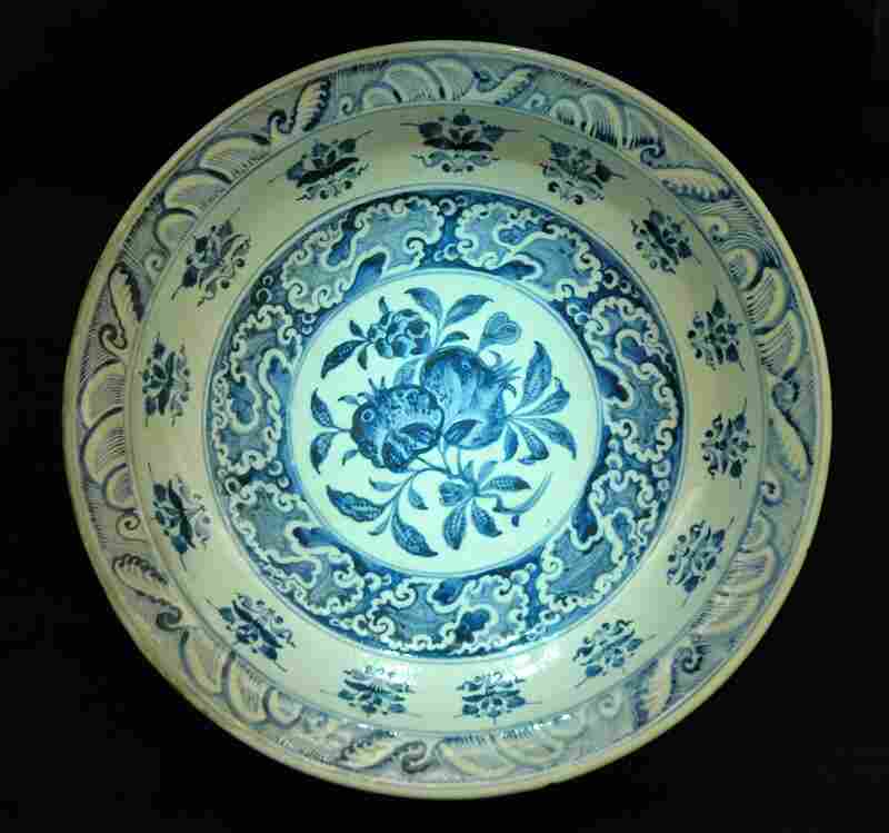 A 16th-century plate from what is now Iran, embellished with pomegranates. Many cultures consider the fruit a symbol of fertility.