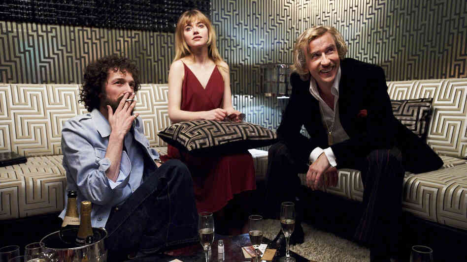 The high life catches up with pop-culture impresario Paul Raymond (Steve Coogan, right) and his daughter Debbie (Imogen Poots) when nudie-mag editor Tony Power (Chris Addison) introduces them to drugs.