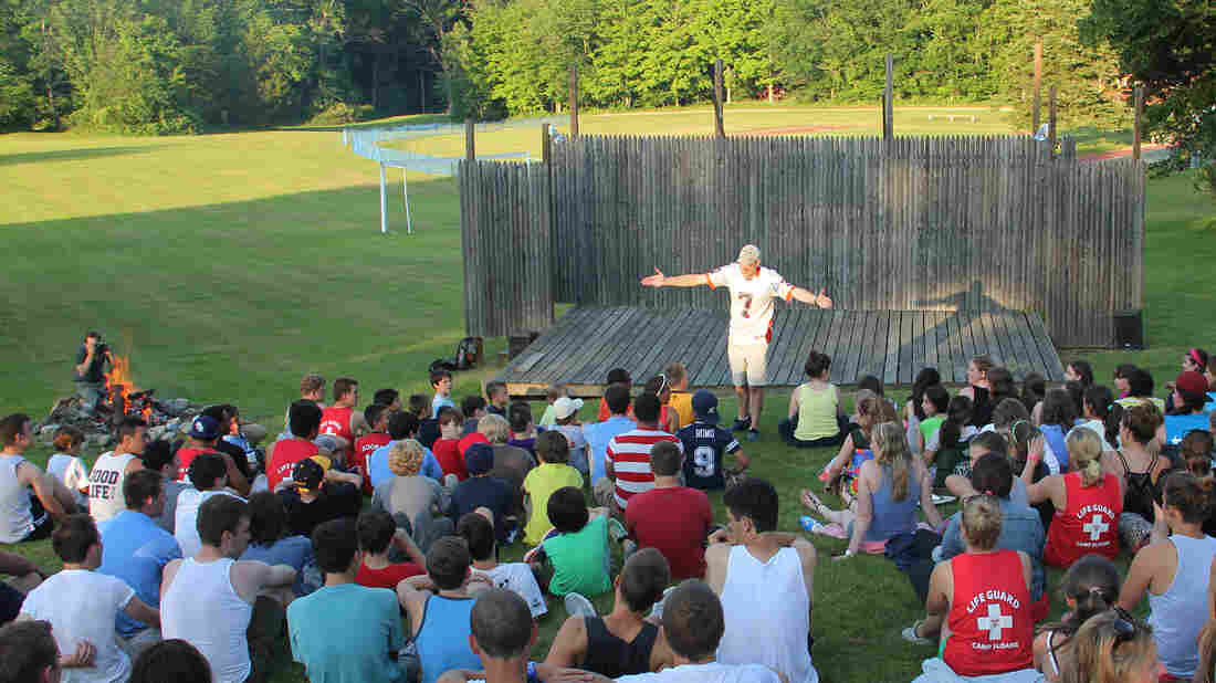 Camp Sloane director Andrew Keener, staff and campers gather for an end of the year campfire last year.