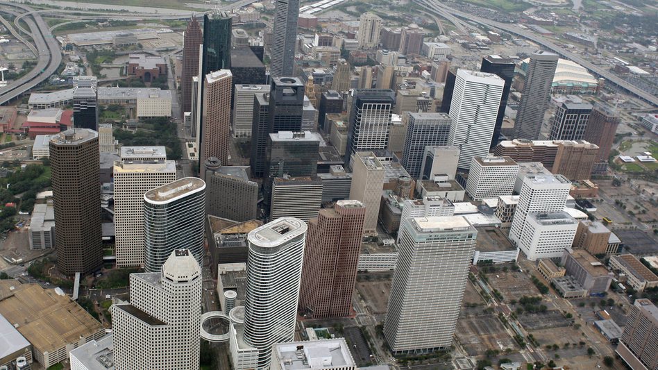 Texas is beginning to trend urban (downtown Houston, left), which could be good news for Democrats, who tend not to do well in rural areas like Wise County near Boyd (right). (AP)