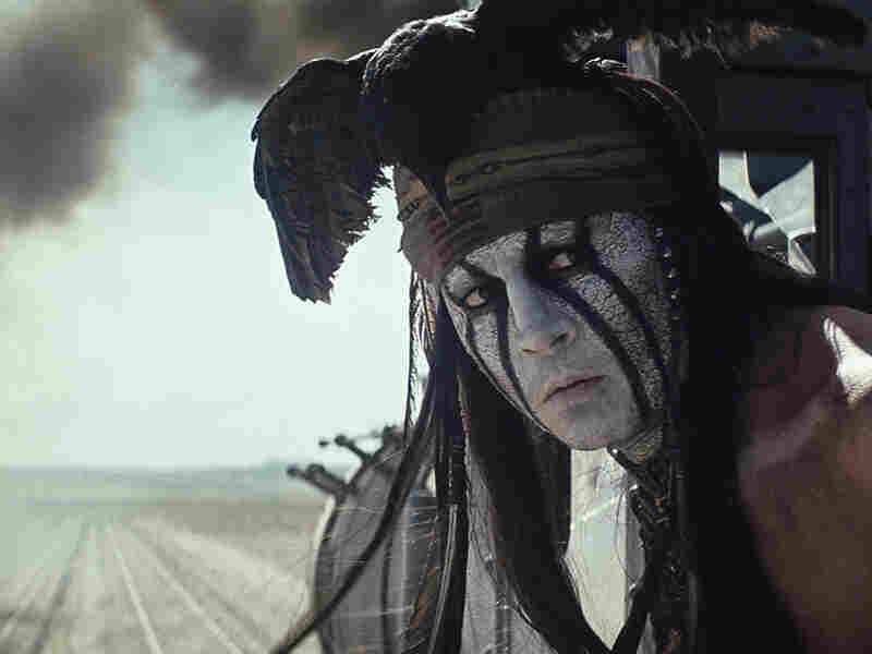 """Adorned with a dead black crow, headband and face paint, Depp said he knew his Tonto would need to go """"against the grain of what had been done before, [he] knew it would require a very, very important iconic look."""""""