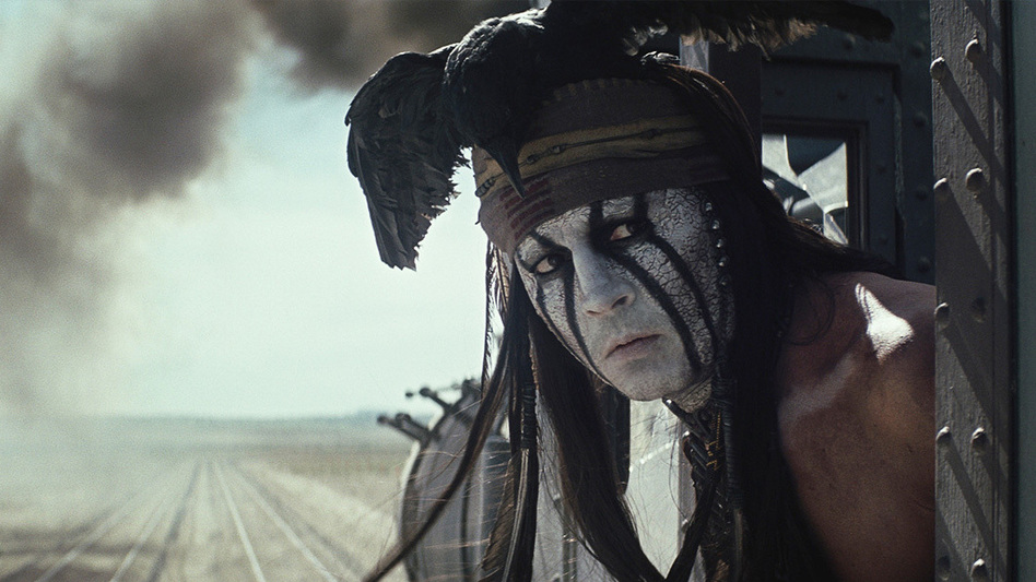 "Adorned with a dead black crow, headband and face paint, Depp said he knew his Tonto would need to go ""against the grain of what had been done before, [he] knew it would require a very, very important iconic look."" (Disney)"