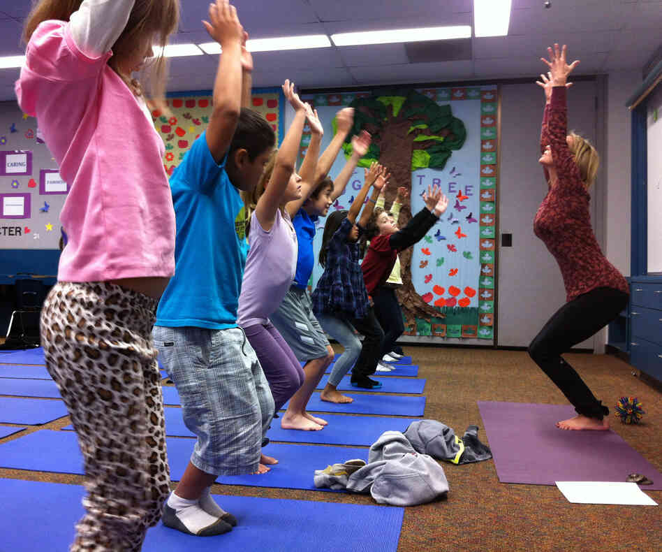 Third-graders at Olivenhain Pioneer Elementary School in Encinitas, Calif., perform chair pose with instructor Kristen McClo
