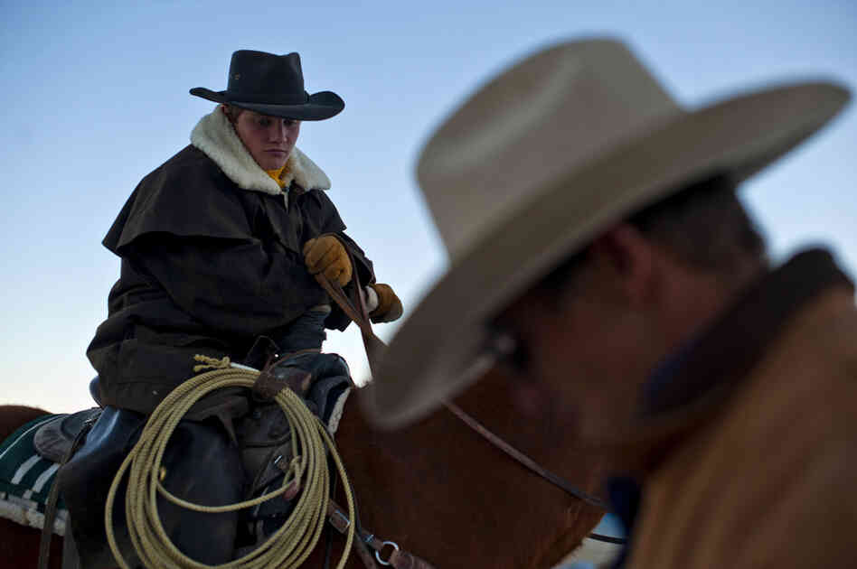 Rancher Dave Baker and his son, Clay, get ready to herd 200 cattle on their ranch in Baker, Nev.