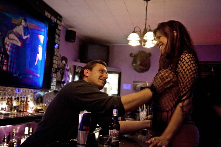 "Bartender Stan Bowditch grabs Jade, who works at Big Four Ranch -- a different kind of ""ranch"" -- in Ely, Nev."