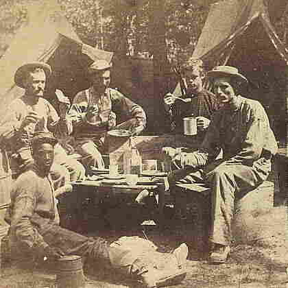 At Least They Had Real Coffee: Union soldiers eat and drink in front of tents.