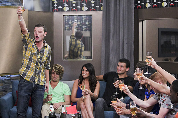 Houseguest Judd makes a toast during the season premiere of Big Brother.
