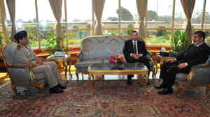 "Before The Fall: Then-Egyptian President Mohammed Morsi (right) met Monday with Prime Minister Hesham Kandil (center) and Defense Minister Gen. Abdel-Fattah al-Sisi in Cairo. Since then, the military has ousted Morsi, suspended the constitution and imposed a ""road map"" for political transition in Egypt after the president refused calls to step down."