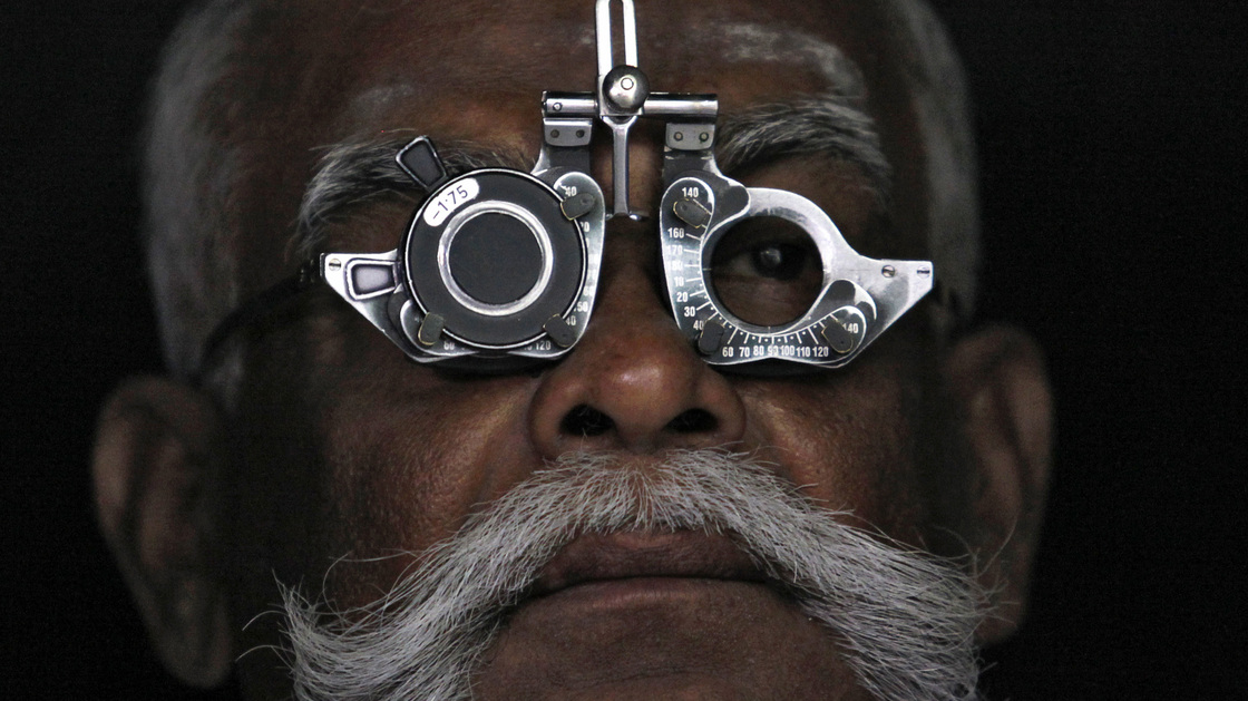 A man gets an eye exam at an Aravind Eye Care clinic in Madurai, India.
