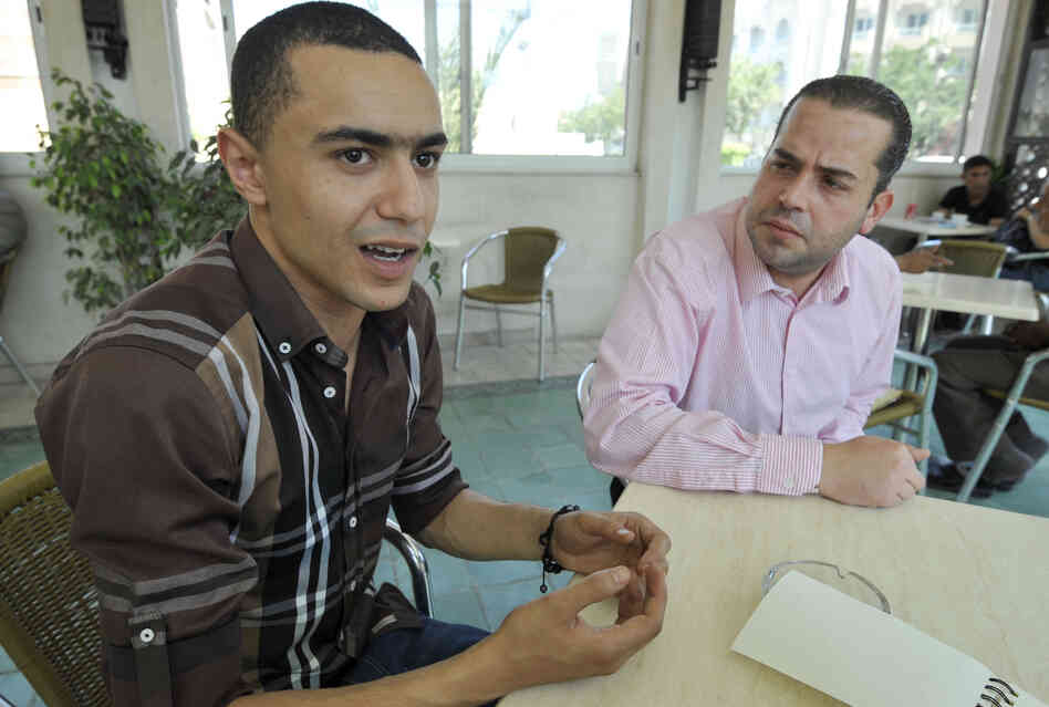 Tunisian rapper Ala Yaacoubi, also known by his rap name Weld El 15, left, speaks alongside his lawyer, Ghazi Mrabet, before his trial last month.