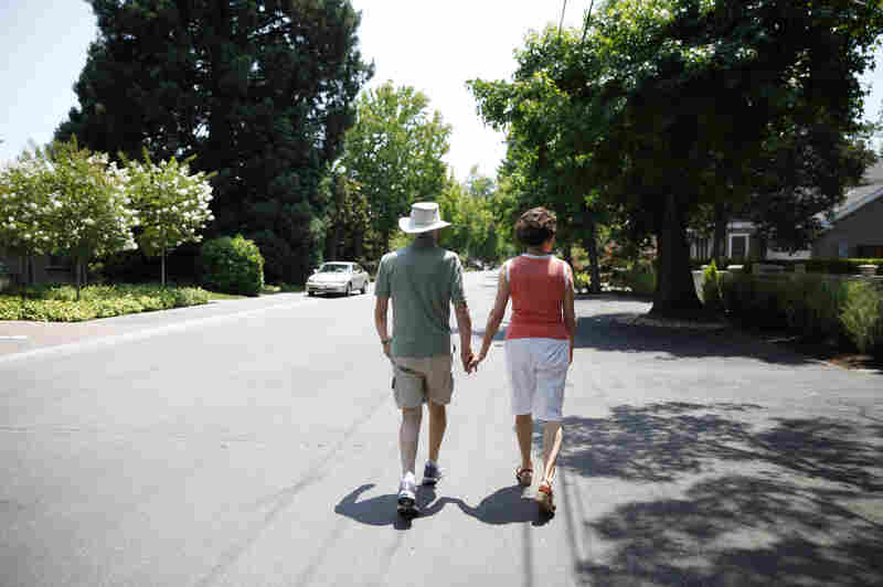 Robin and Anne Jones take a walk near their home. They say that an Alzheimer's biomarker test made it easier to plan for the future.