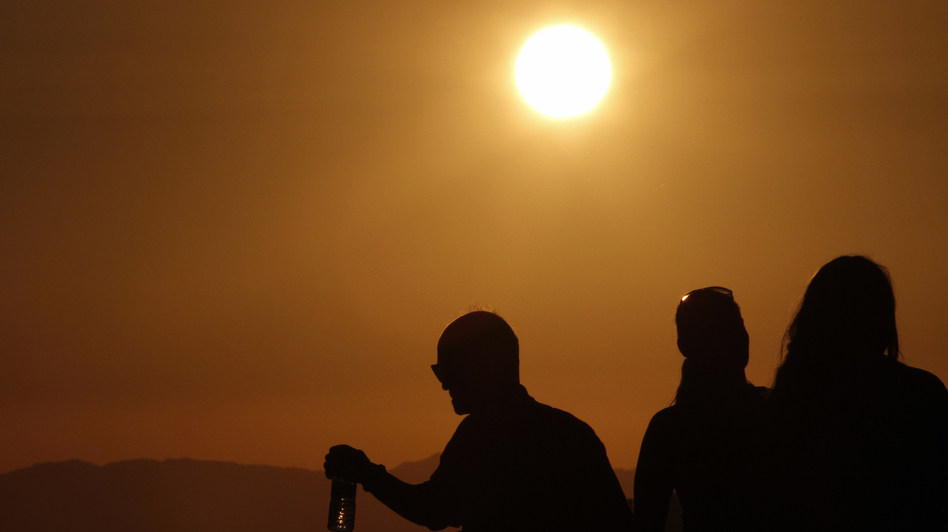 Oh, baby it's hot: The sun shines down on people standing atop the roof of the Griffith Observatory in Los Angeles, one of the cities in the grips of a dangerous heat wave. (Reuters /Landov)