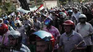 Egyptian President Mohammed Morsi says he will not resign, despite a military demand that he reach a compromise with critics. Here, Morsi supporters take part in a drill during a demonstration in the suburb of Nasr City Tuesday.