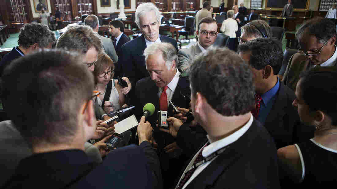 Texas reporters surround state Sen. Kirk Watson, D-Austin, on Monday.