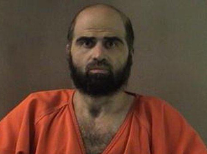 Maj. Nidal Hasan faces 13 charges of murder and 32 of attempted murder for the November 2009 shootings at Fort Hood. A Muslim, he has refused a judge's order to shave his beard, though it violates Army regulations. The trial will proceed, however.