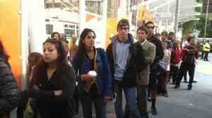 Frustrated commuters wait at the Transbay Temporary Terminal in San Francisco to catch a bus over to Oakland on Tuesday.