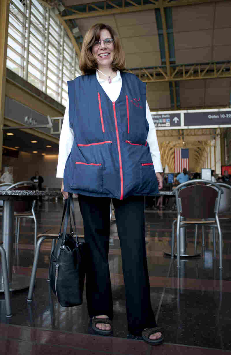 "NPR's Marilyn Geewax displays her ""wearable luggage"" at Reagan National Airport. But a bulging vest is likely to draw scrutiny from security guards."