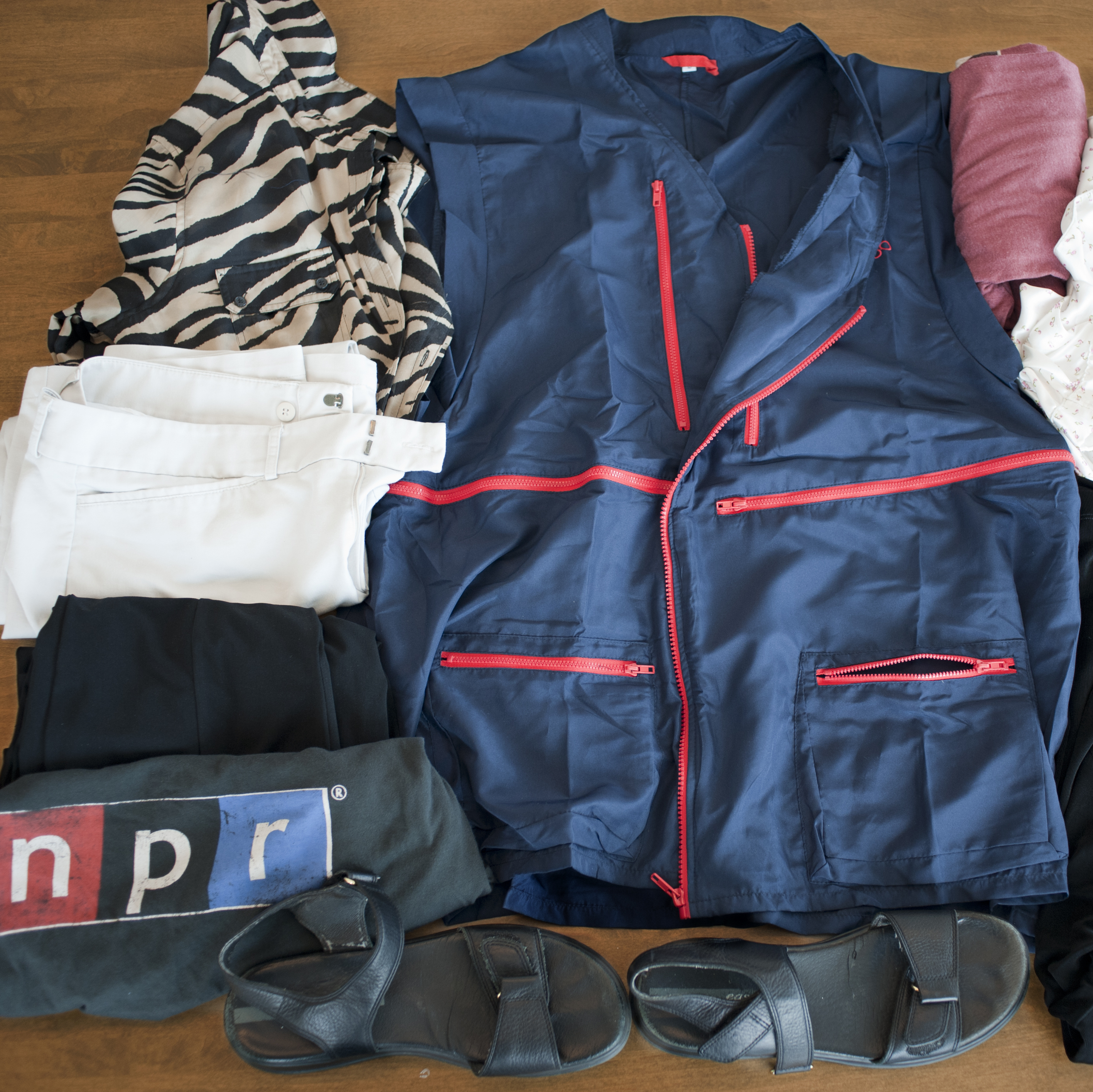 "The ""wearable luggage"" vest, surrounded by the contents NPR's Marilyn Geewax packed in it for her hypothetical weekend trip."