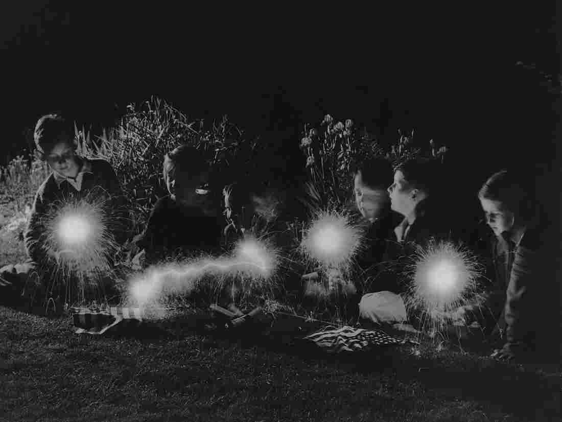 Children play with sparklers, July 4, 1940