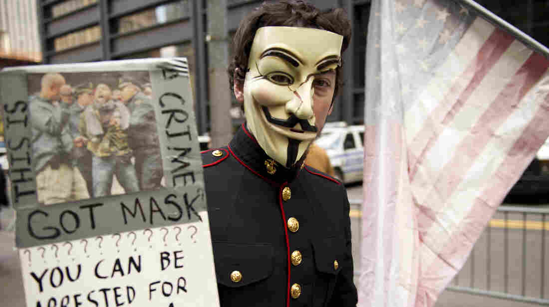 New York: A young man with an Anonymous mask marches with Occupy Wall Street protesters on Nov. 11, 2011, at Zuccotti Park in New York.